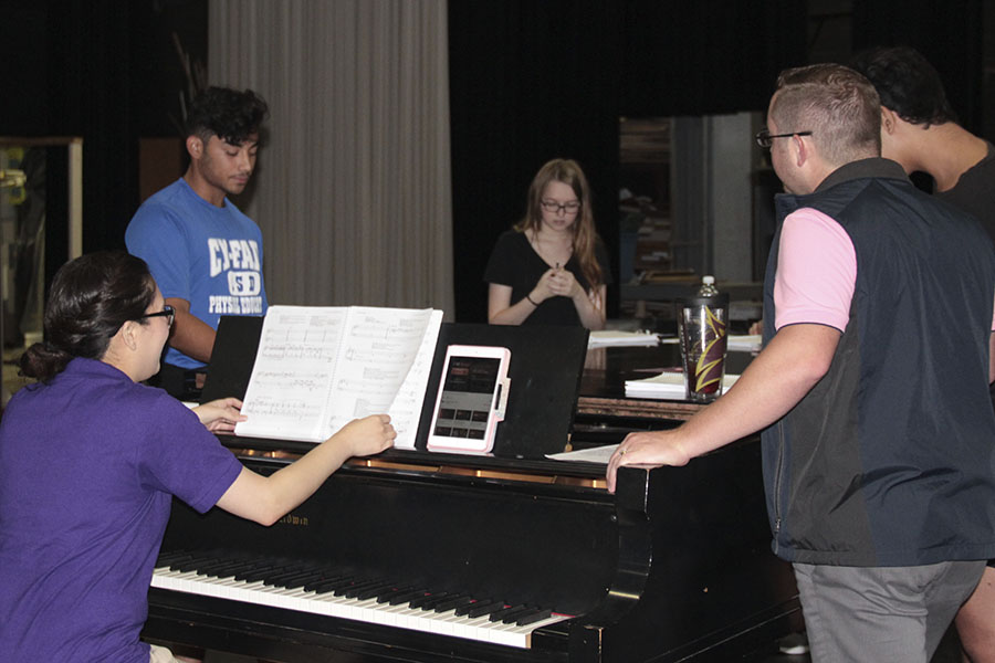 Taking command of the vocal and orchestra alumni Chester Hilborn and Priscilla Salisbury work with JV Players actors. Photo by Keren Salinas