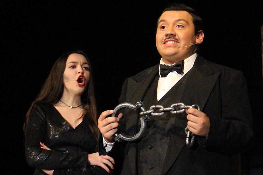 Playing the roles of the happily married couple Gomez and Morticia Addams, senior Julio Gonzalez and sophomore Leila Bixby capture the audience's attention with hilarious dialogue about their daughter's boyfriend.