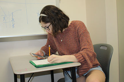 Preparing for the math section of the ACT junior Kristin Shires reviews her work to ensure that she has a complete understanding of the process to be used for a successful ACT score.