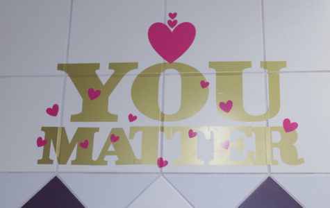 Motivational decorations line girls' restroom walls
