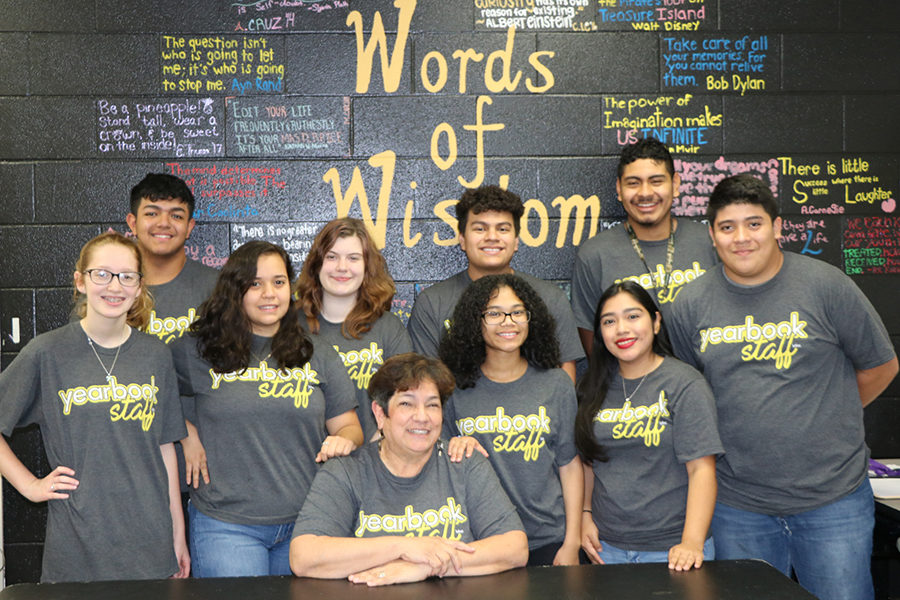 Journalism+teacher+and+JVHS+Student+Press+adviser+Margie+Comstock+%28seated%29+is+surrounded+by+some+of+her+yearbook+students+in+celebration+of+the+longtime+educator+being+awarded+the+Texas+Association+of+Journalism+Educators+%28TAJE%29+Trailblazer+Award+on+Oct.+21+at+the+association%E2%80%99s+Fall+Fiesta+Convention+in+San+Antonio.