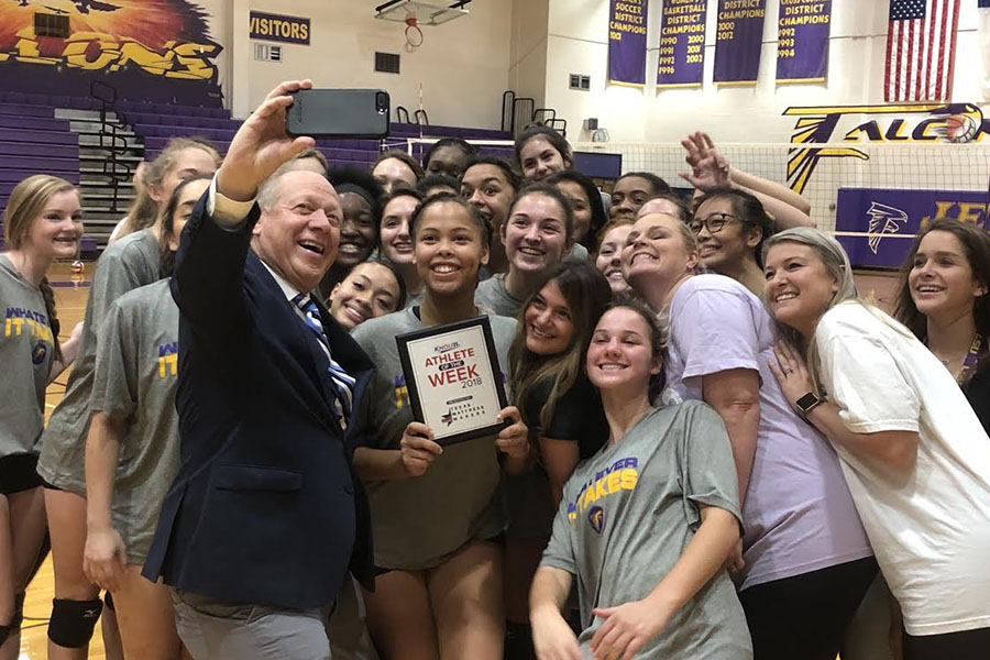 Pictured with her volleyball teammates, coaches and KHOU reporter Matt Musil, senior Alexis Marion receives the KHOU Athlete of the Week award for the week of October 9, 2018.