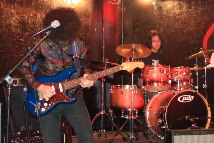 After the first chord the crowd became captivated. As the music picked up the crowd jumped along in unison electricity filling the air. Michael Jeudy (left) on the electric and Kareem (right) playing drums at the White  Swan. Their hard work and dedication show through the passion they have as they play.