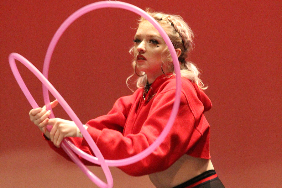 "Candace Asmus, senior, performs a hula hoop routine to the song ""Yes Indeed"" by rapper Drake. The crowd cheered as Asmus performed the routine which included many moves and sang along to the song. Asmus performed the routine many times throughout the day, which caused much buzz around the school."