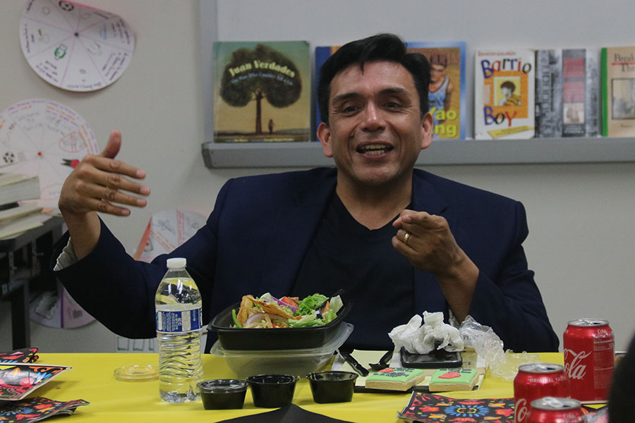 """On May 14 ESL (English as a Second Language) program students welcomed author, Tony Diaz,  known as """"El Librotraficante.""""  He spoke about his book, """"The Aztec Love God.""""  Students shared a meal and chatted with the author."""