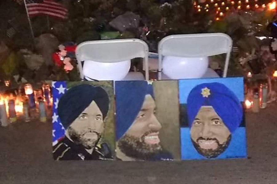 Cypress+Falls+High+School+alumnus+Sergio+Martinez+Jr.+painted+three+portraits+of+Harris+County+Sheriff%E2%80%99s+Deputy+Sandeep+Dhaliwal%2C+who+was+killed+in+the+line+of+duty+on+Sept.+27.+Portraits+will+be+gifted+to+Dhaliwal%E2%80%99s+family+and+partner%2C+while+the+agency+has+approached+Martinez+about+producing+another+to+showcase+in+the+department.