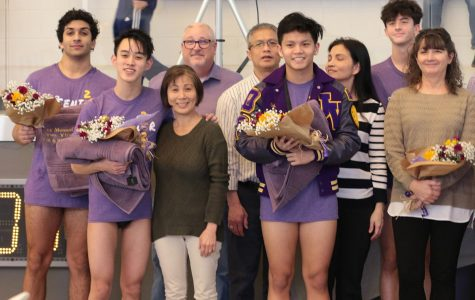 With family members supporting them,  Alex Mosaffa, Jake Tran, Eric Dao, and Dylan Stonebraker, seniors, show off their gifts given to them in honor of their dedication to their sport.